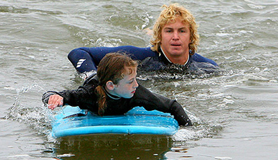 dad and daughter surfing