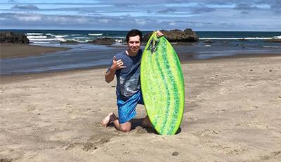 man posing at the beach