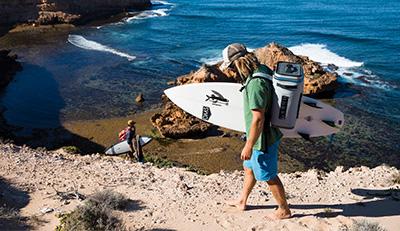 surfer carrying backflip